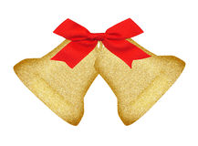 Golden Christmas bells and red bow isolated on white Royalty Free Stock Image