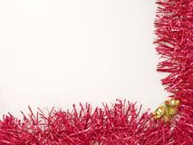 Golden christmas bells and red decoration. Stock Image