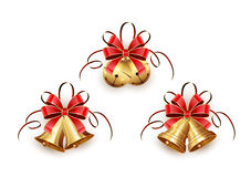 Golden Christmas bells with red ribbon Stock Photography