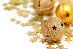Golden Christmas bells and stars Royalty Free Stock Photos