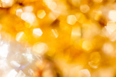 Golden Christmas Bokeh Background. Gold Holiday glowing Abstract Glitter Defocused Royalty Free Stock Photography