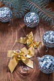 Golden christmas bows and mirror disco balls with pinetree branc Stock Images