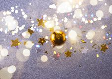 Silver and golden christmas bubbles. Golden christmas bubble with stars on silver background with shining bokeh lights stock photo