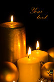 Golden Christmas Candles Stock Image