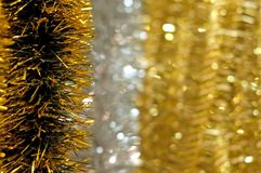 Golden christmas chain on bokeh background Royalty Free Stock Photos