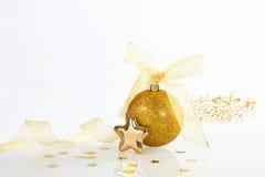 Golden christmas decoration. Golden shiny christmas decoration on white background stock photography