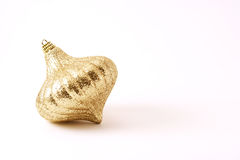 Golden Christmas decoration. On white background Royalty Free Stock Photos