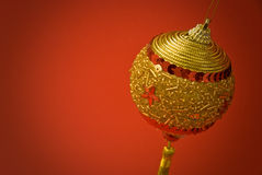 Golden Christmas decoration. Christmas decoration on red background Stock Photography