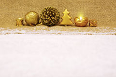 Golden Christmas decoration and advent candle. Stock Photography