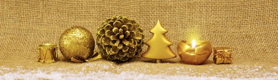 Golden Christmas decoration and advent candle. Stock Image