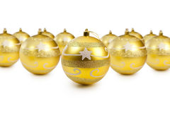 Golden christmas decoration balls. On white background with copy space Stock Image