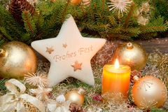 Golden christmas decoration with burning candle and german text Royalty Free Stock Images