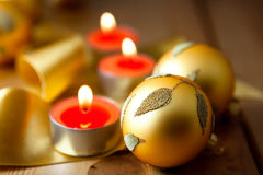 Golden christmas decoration and candles Royalty Free Stock Photo