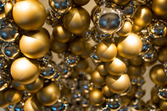 Golden christmas decoration or garland of beads Stock Image