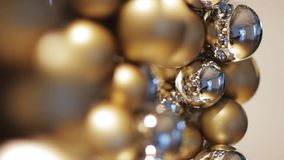 Golden christmas decoration or garland of beads stock video