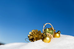 Golden christmas decoration in the snow Stock Images