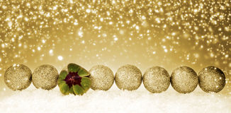Golden Christmas decoration with snow and cloverleaf. Green clover leaf and christmas balls. Happy symbols: four leaf clover and snow. Golden Christmas Royalty Free Stock Images