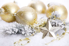 Golden Christmas decoration with snow stock image