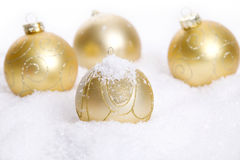 Golden Christmas decoration with snow royalty free stock photos