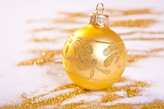 Golden Christmas Decoration. Spilled glitter Stock Photo