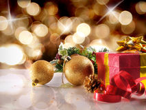 Golden Christmas decoration with two balls and gift Horizontal c Royalty Free Stock Image