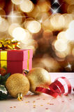 Golden Christmas decoration with two balls and gift Vertical com Royalty Free Stock Photo