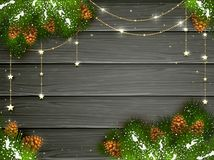 Golden Christmas decorations on black wooden background Royalty Free Stock Photo