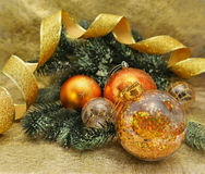 Golden Christmas decorations with conifer Stock Photography