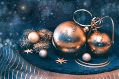 Golden Christmas decorations on dark background Stock Image