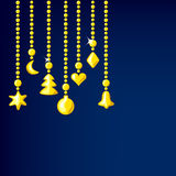 Golden Christmas decorations on a dark background Royalty Free Stock Photography