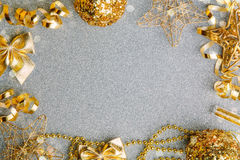 Golden Christmas decorations on glitter background Stock Images