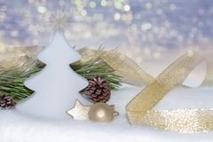Golden Christmas decorations, ornaments on bokeh lights background Royalty Free Stock Photo