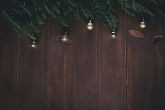Golden Christmas decorations and pine branches on a wooden vintage background Stock Photography