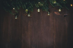 Golden Christmas decorations and pine branches on a wooden vintage background Stock Photo