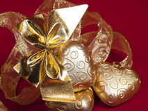 Golden Christmas decorations on a red background Stock Images