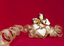 Golden Christmas decorations on a red background Royalty Free Stock Photography