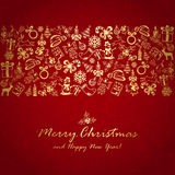 Golden Christmas decorations on red background Royalty Free Stock Images