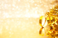 Golden Christmas decorations on shiny background with copy space Stock Photos