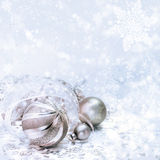 Golden Christmas decorations on winter background Stock Images