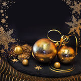 Golden Christmas decorations on winter background Royalty Free Stock Images