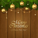 Golden Christmas decorations on wooden background Stock Photos