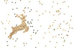 Golden Christmas deer on golden stars background. stock photo