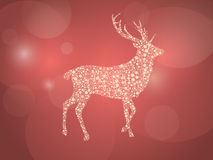 Golden christmas deer on a red and shining background. One golden christmas deer made from stylized snowflakes on a red background with glittering flash of light Stock Illustration