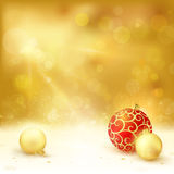 Golden Christmas design with red and golden baubles Stock Photos