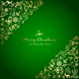 Golden Christmas elements in corner on green background Stock Photos