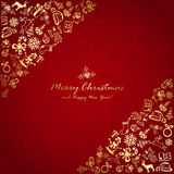 Golden Christmas elements in corner on red background Royalty Free Stock Photos