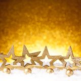 Golden christmas fir stars decoration with gold and red ornaments Stock Photos