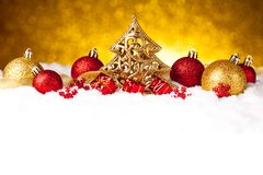 Golden christmas fir tree decoration with gold and red ornaments Stock Photo