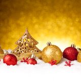 Golden christmas fir tree decoration with gold and red ornaments Royalty Free Stock Photos