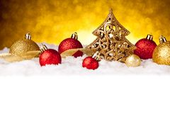 Golden christmas fir tree decoration with gold and red ornaments Stock Image